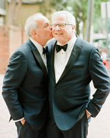 groom kissing husband on cheek
