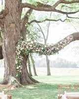 Tree Branch Wedding Arbor with Purple, Pink, and White Flowers
