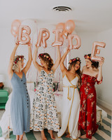 guests holding up bride balloons