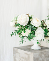 compote centerpieces white flowers against white backdrop