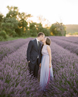 destination engagement couple kissing in lavender field