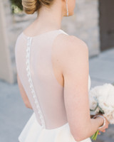A Bride with a Wedding Dress That Has Details Along the Spine