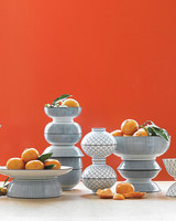 Orange and Vessel Wedding Centerpiece