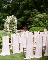 gloria zee wedding ceremony chairs arch