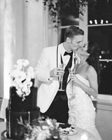 kate austin wedding cake cutting kiss bw