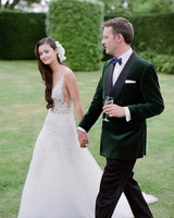 peony matthew england wedding couple in reception attire holding hands
