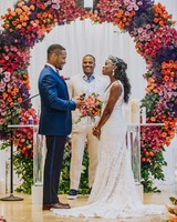 bride groom wedding ceremony vows floral arch