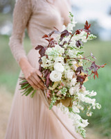 contrasting white roses and dark japanese maple bouquet