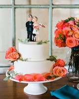 wedding cake with vibrant flowers