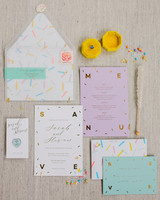 vellum envelopes with candy-colored accents and confetti