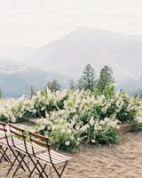 wedding ground overgrown white floral arches
