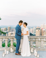 couple on balcony overlooking city