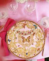 bridal shower pink table setting with butterfly decor plate