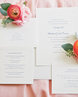 white wedding invitation with blue ink