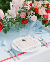 colleen stephen newport wedding place setting with red and pink flowers