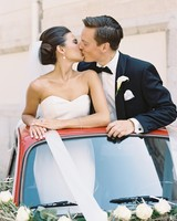 Bride and Groom Standing in Car Sunroof