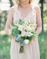 bridesmaid holding a dogwood bouquet