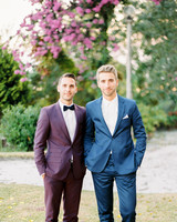 men wearing burgundy and blue suits