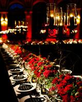 A Table Setup of a Dark Wedding Venue