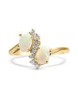 gold bypass opal engagement ring