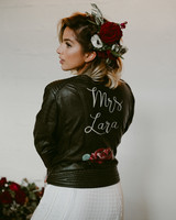 leather jacket with painted name and flowers