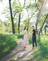 couple walking on greenery path engagement