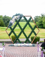 wedding backdrop installation geometric floral greenery