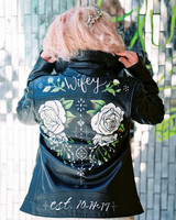 black leather jacket with painting