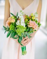 Bride Holding a Light Pink Wedding Bouquet