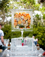 wedding ice sculpture frozen water dispenser with oranges
