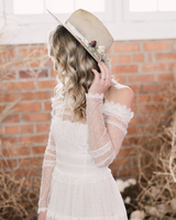 bride wearing tan hat with pink details