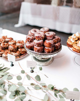 eucalyptus branches on treat table with donuts