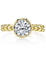 Evelyn H. yellow gold leaf detailed band and solitaire diamond engagement ring