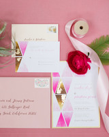 geometric wedding invitations painted pink with triangles