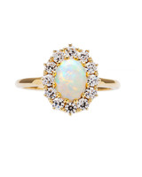 opal stone surrounded by diamonds and gold engagement ring