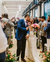 bride groom kiss aisle guests applaud