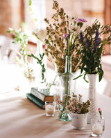 wedding centerpiece white vases candles purple flowers