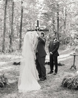 ashley and justin lifting veil at processional