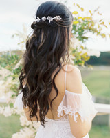 sparkly, leaf-like hairpiece in half-up half-down hairstyle
