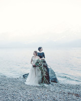 couple standing on shore of lake como