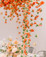 orange carnations suspended above table