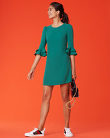 short green fall guest wedding dress with ruffled sleeves