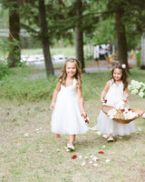flower girls throwing red and white petals