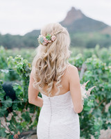 succulents hair piece in half-up half-down curled hair