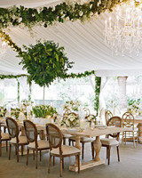 47 hanging wedding dcor ideas martha stewart weddings tent wedding reception with greenery garlands and chandeliers junglespirit Image collections