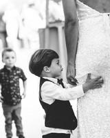 ring bearer holding onto bride