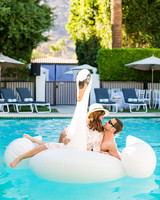 A Bride and Groom Relaxing in a Pool