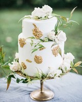 White and Gold Wedding Cake on a Gold Cake Stand