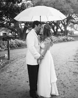 A Couple Kissing Under an Umbrella