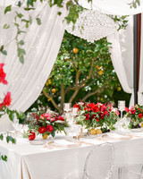 Head Table with Red Flowers and a Crystal Chandelier